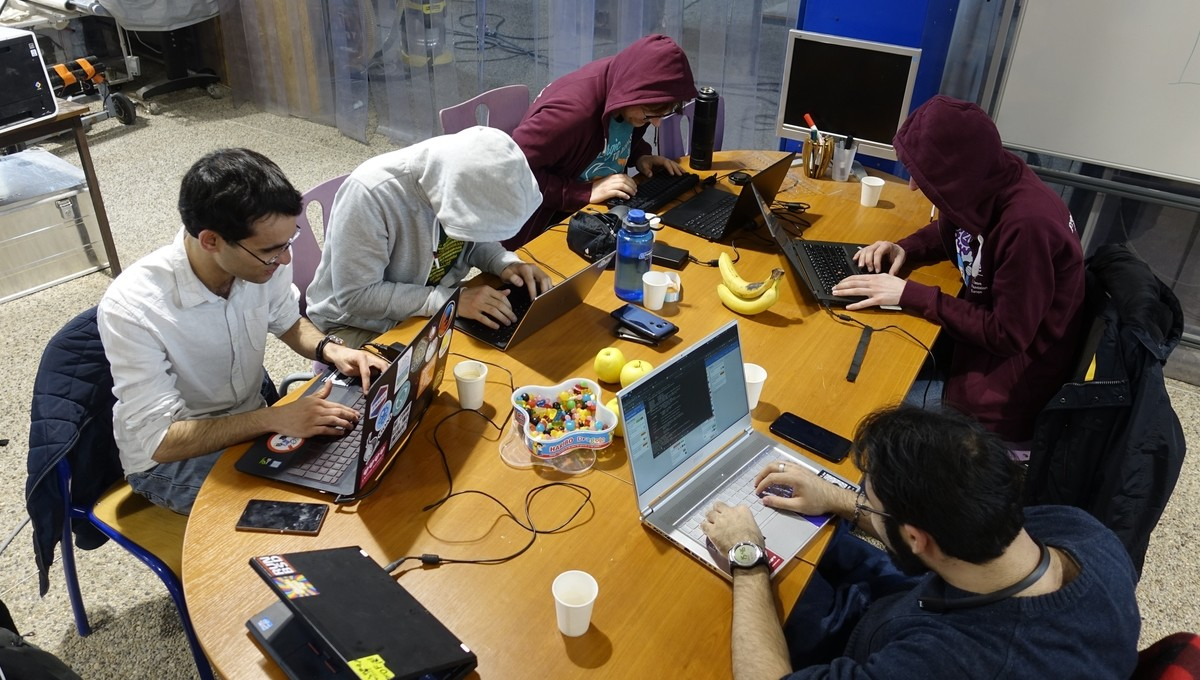Hackers in their natural working environment. For the picture we took off the black ski masks and gloves.